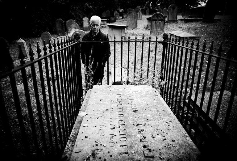 Ian McMillan photographed by the grave of Ebenezer Elliott
